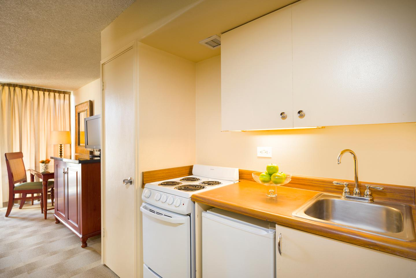 and cabinets hotel appliances size luxury room deluxe with wood kitchen suite accommodations full